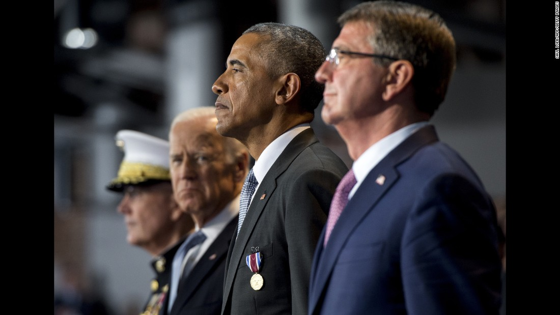 US President Barack Obama stands with US Secretary of Defense Ashton Carter, right, Vice President Joe Biden, second left, and Gen. Joseph Dunford, chairman of the Joint Chiefs of Staff, during the Armed Forces Full Honor Farewell Review for Obama at Joint Base Myer-Henderson Hall in Arlington, Virginia, on Wednesday, January 4.