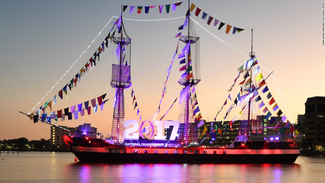 "The Alabama Crimson Tide and Clemson Tigers are vying for the College Football Playoff National Championship on Monday, January 9, in Tampa, Florida. Here, the ""pirate"" ship Jose Gasparilla celebrates the playoff game with an illuminated sign in Hillsborough Bay near downtown Tampa. Check out some highlights from the two teams' earlier games:"