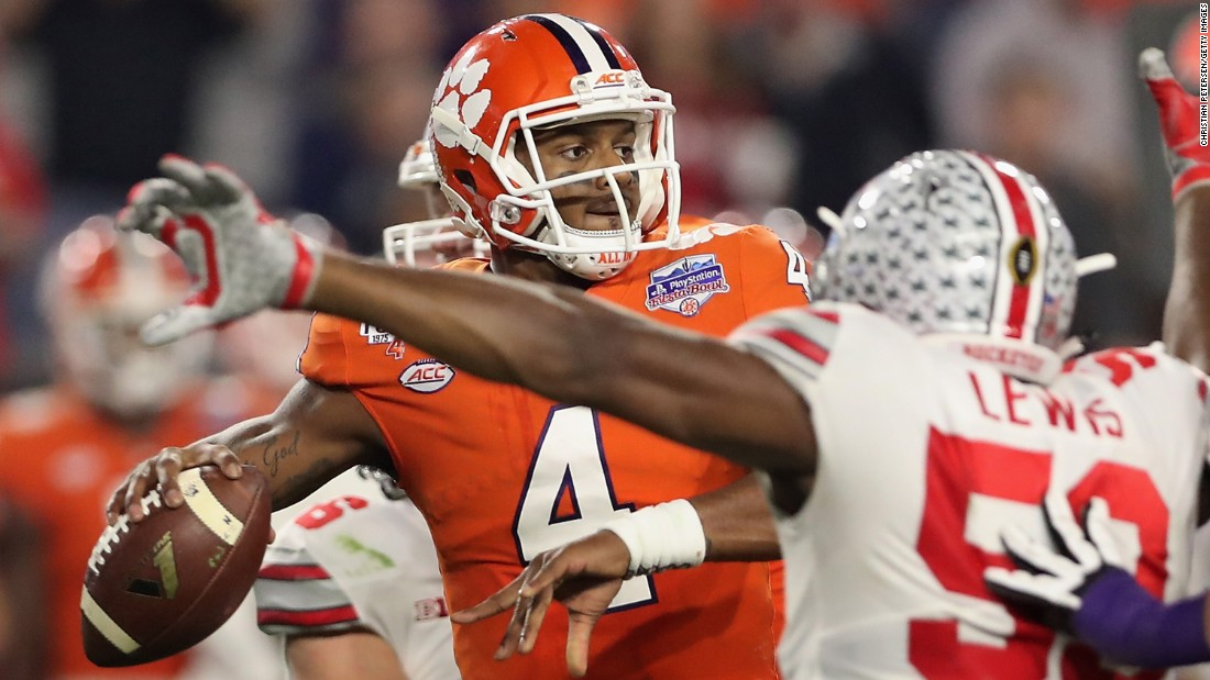 Clemson shut out Ohio State 31-0 in the PlayStation Fiesta Bowl in Glendale, Arizona, on December 31. Clemson quarterback Deshaun Watson faces pressure from Ohio State defensive end Tyquan Lewis to pass during the game.