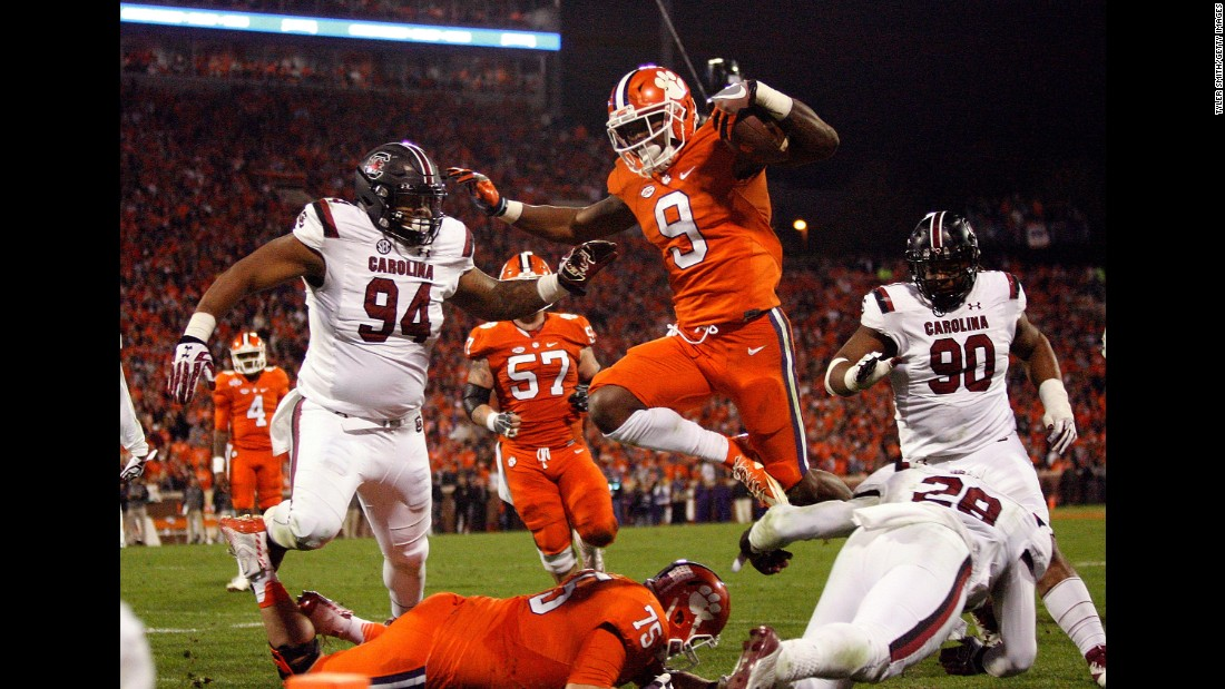 Clemson running back Wayne Gallman leaps into the end zone for a touchdown during a November 26 game against the South Carolina Gamecocks in Clemson.