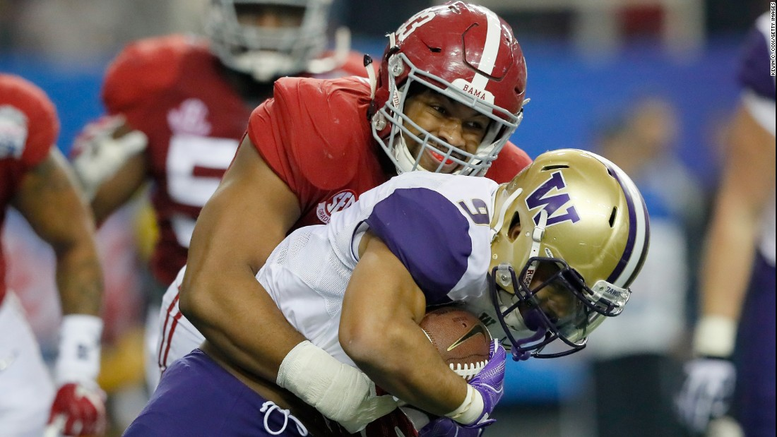 Alabama defensive lineman Jonathan Allen tackles Washington running back Myles Gaskin during the Chick-fil-A Peach Bowl in Atlanta on December 31.
