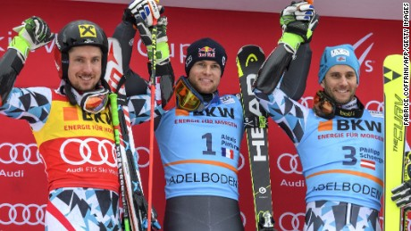 Winner Alexis Pinturault is flanked by Marcel Hirscher (left) and third-placed Philipp Schoerghofer on the Adelboden podium.