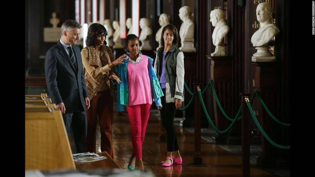 The first lady and her daughters receive an escort from Patrick Prendergast, provost and president of Trinity College Dublin, during their June 2013 visit to Ireland.