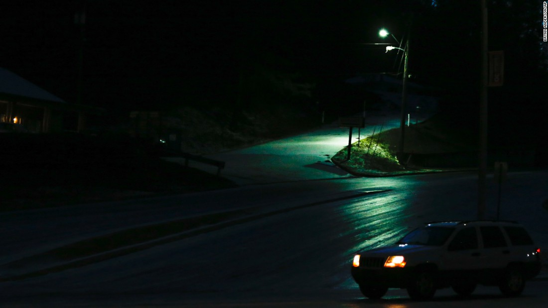 A car travels down icy roads early Saturday, January 7, in Hoover, Alabama. Gov. Robert Bentley declared a state of emergency, putting 300 Alabama National Guard soldiers on standby.