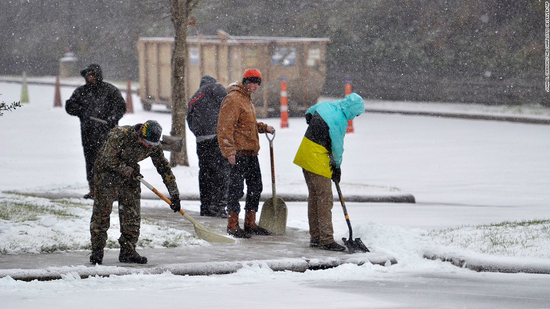 Workers clear the sidewalks of an office park on January 7 in Charlotte, North Carolina.