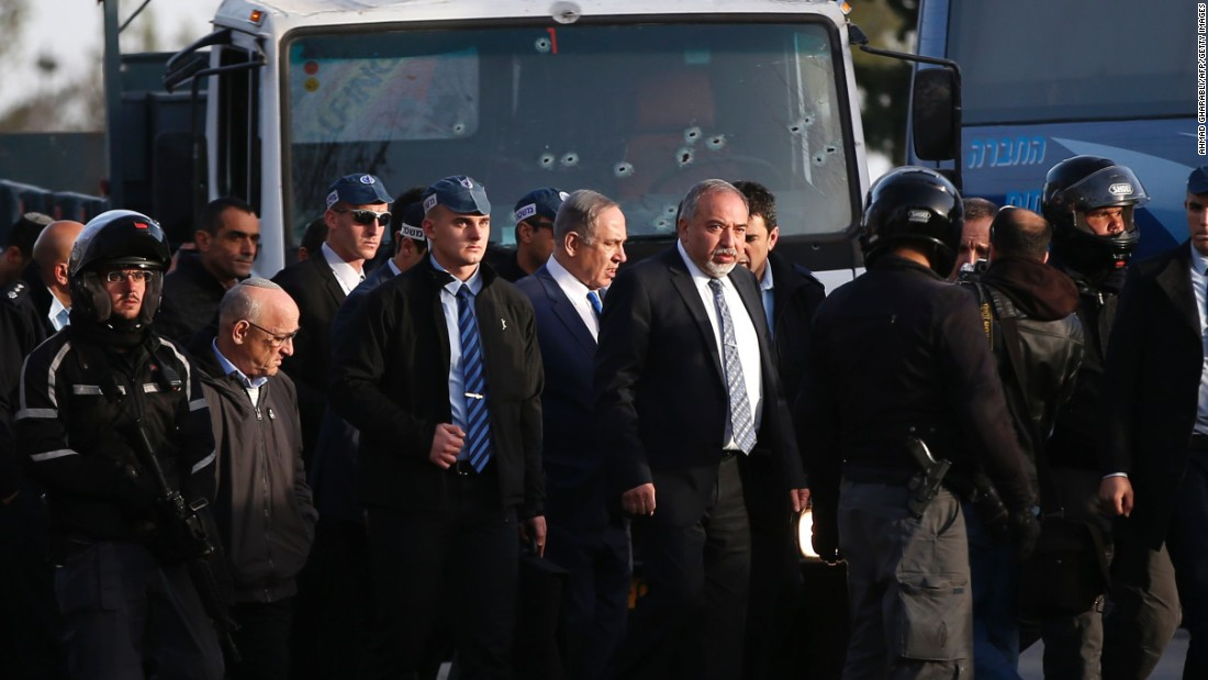 Israeli Defense Minister Avigdor Lieberman, center right, and Prime Minister Benjamin Netanyahu visit the site of the attack.