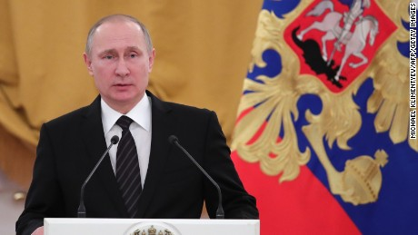 Russian President Vladimir Putin delivers a speech during a reception dedicated to the celebration of the New Year at the Kremlin in Moscow on December 28, 2016.