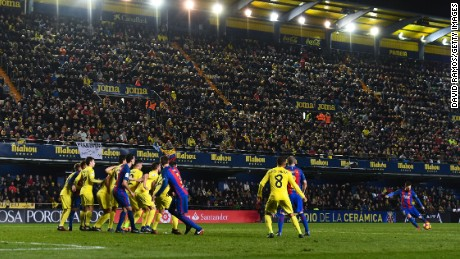 Lionel Messi finds the top corner to secure Barca a point at Villarreal.