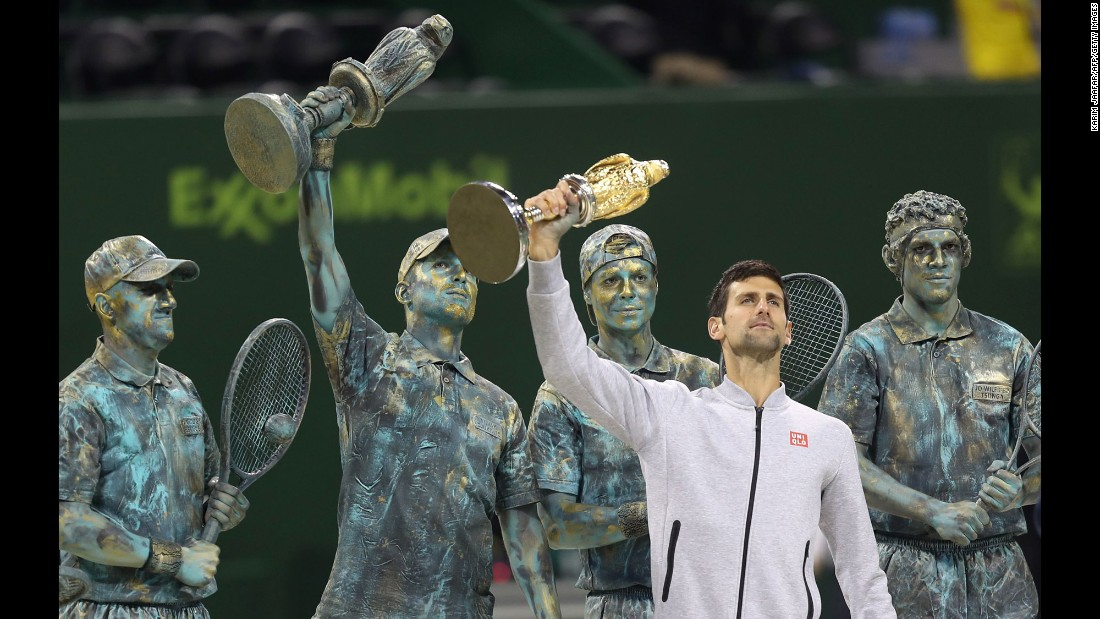 "Novak Djokovic holds up his trophy after winning the Qatar Open final on Saturday, January 7. Behind him were human statues of past Qatar Open champions, including Djokovic himself (raising the trophy). Djokovic <a href=""http://www.cnn.com/2017/01/07/tennis/tennis-qatar-djokovic-murray/index.html"" target=""_blank"">defeated Andy Murray in the final,</a> ending Murray's 28-match unbeaten run."