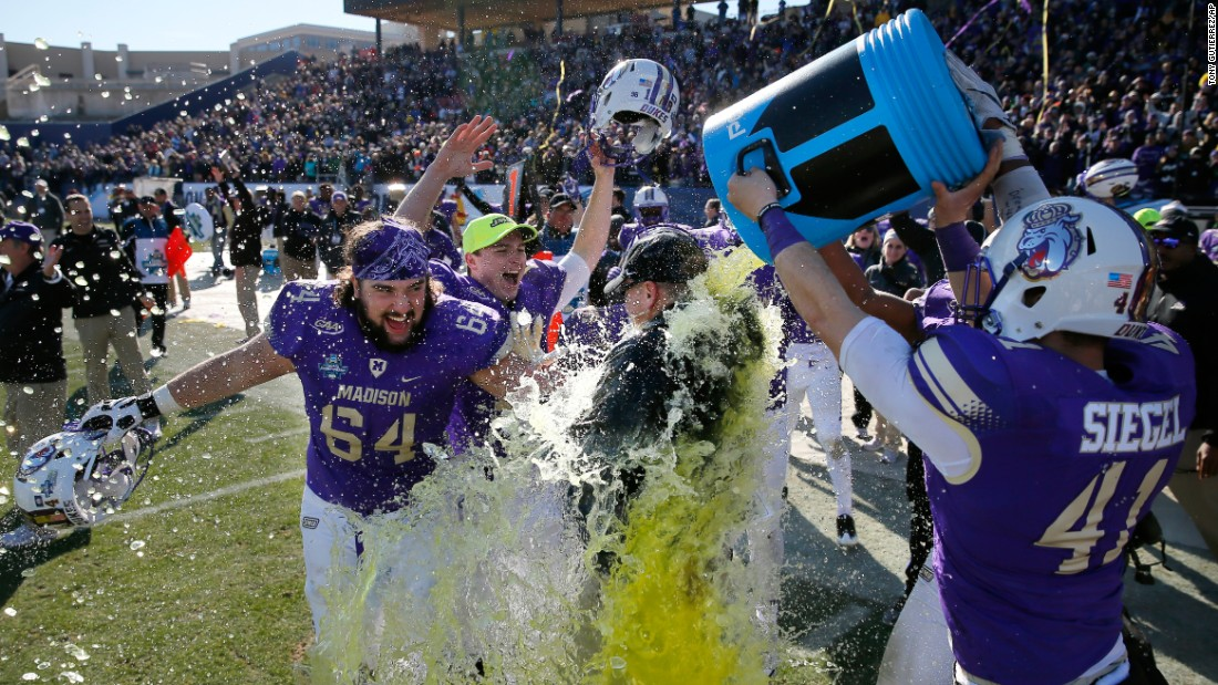 James Madison head coach Mike Houston is doused after the Dukes won the FCS championship game on Saturday, January 7. James Madison defeated Youngstown State 28-14 in Frisco, Texas.