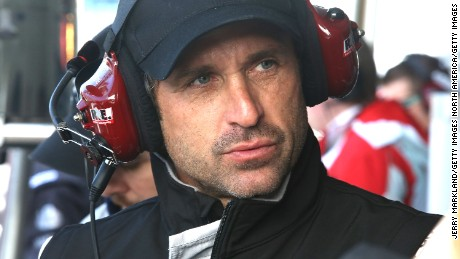 DAYTONA BEACH, FL - JANUARY 23:  Patrick Dempsey, co-driver of the #27 Dempsey Racing Porsche 911 GT America waits in the pit area during practice for the Rolex 24 at Daytona International Speedway on January 23, 2014 in Daytona Beach, Florida.  (Photo by Jerry Markland/Getty Images)
