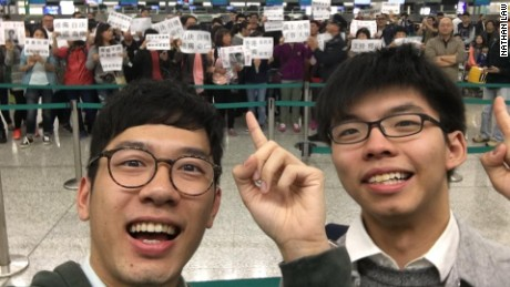 Hong Kong pro-democracy politicians Nathan Law and Joshua Wong pose for a selfie with protesters targeting them.