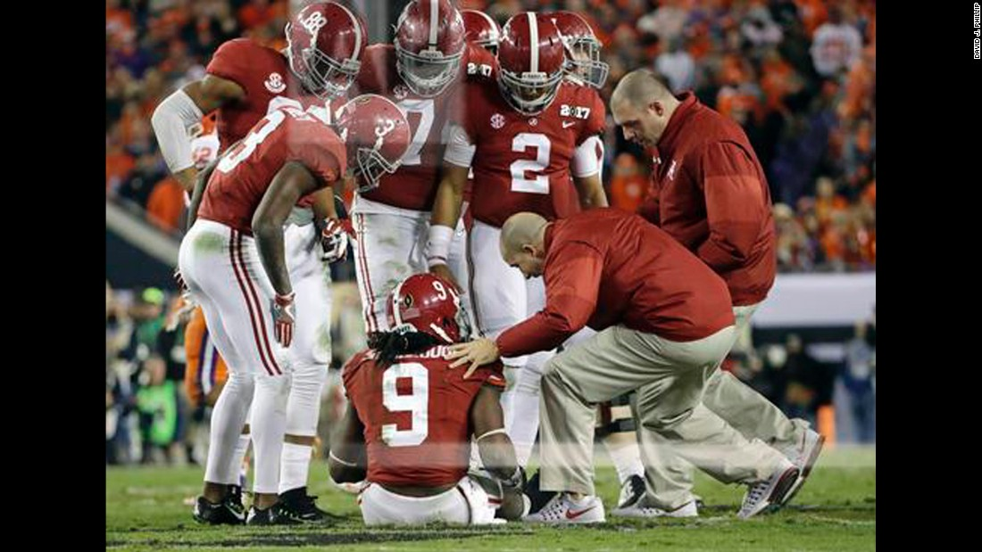Alabama running back Bo Scarbrough is looked at by trainers after getting hurt in the second half. He didn't return to the game. Scarbrough had two touchdowns in the first half.