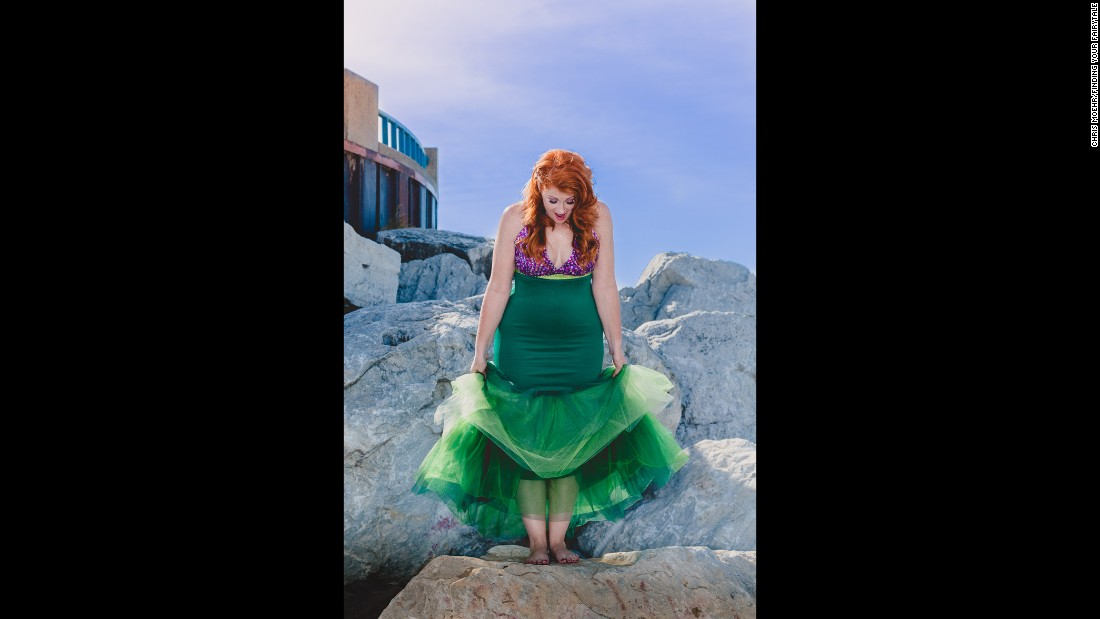 The Little Mermaid wanted to walk on land and felt like an outcast in the sea. May was bullied and teased as the outcast as a child. She's shown standing confidently on her own two feet.