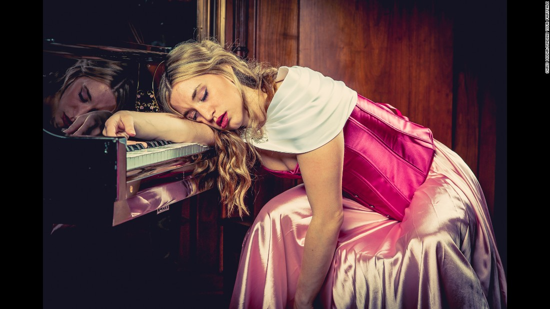 Angie Kupper, who struggled with narcolepsy, as Sleeping Beauty. Kupper created fairy-tale portraits like this one to depict struggles people overcame in real life.