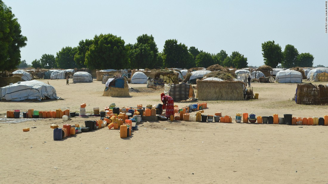 Families have to line up their cans near a bore hole for their daily water collection.
