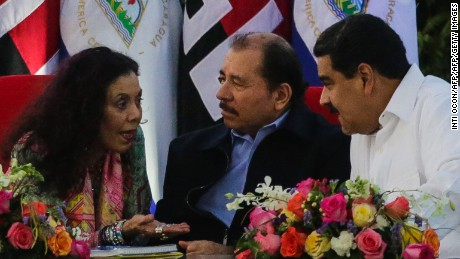 Nicaraguan President Daniel Ortega (C), Venezuelan President Nicolas Maduro (R) and Nicaraguan Vice-President Rosario Murillo talk during the inauguration ceremony for his fourth term in office in Managua on January 10, 2017. / AFP / INTI OCON        (Photo credit should read INTI OCON/AFP/Getty Images)