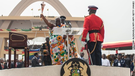 The new president Nana Akufo-Addo waving a Ghanian traditional gold sword during the inauguration in Independence Square in capital Accra last Saturday.