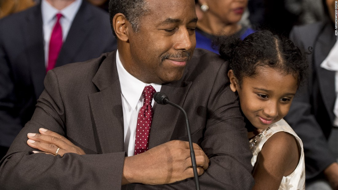 "Carson greets Tesora prior to testifying before the Senate Committee of Banking, Housing and Urban Affairs in January. <a href=""http://www.cnn.com/2017/01/12/politics/ben-carson-hud-confirmation-hearing/"" target=""_blank"">In his opening statement,</a> he noted that he was raised by a single mother who had a ""third-grade education"" and made the case that he understands the issues facing the millions of people who rely on HUD programs."