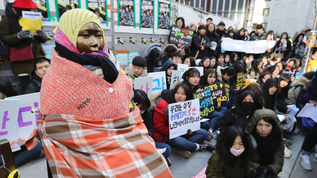 "Students gather near a ""comfort woman"" statue during a rally in front of the Japanese Embassy in Seoul, South Korea for a weekly ""Wednesday demonstration"" on January 11, 2017."