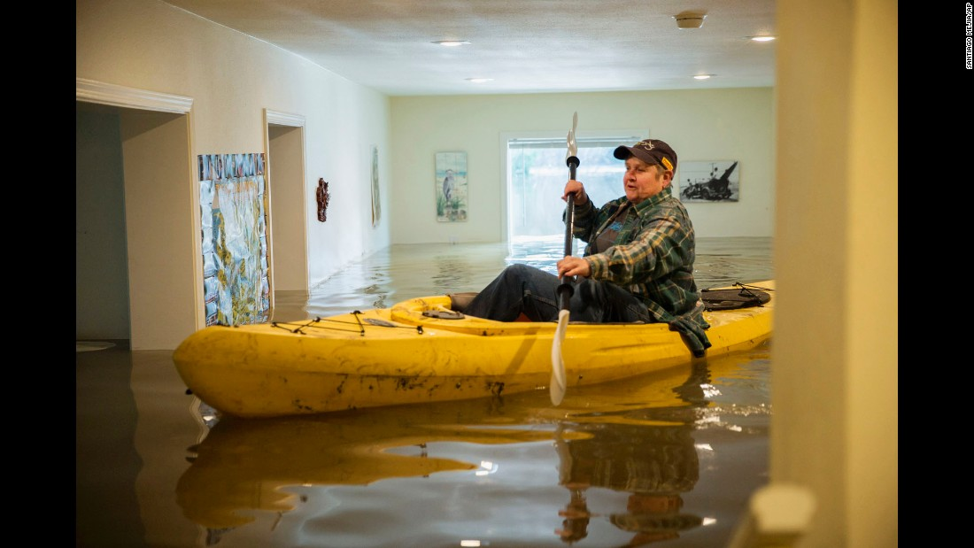 "Lorin Doeleman uses a kayak to check her flooded home in Guerneville, California, on Wednesday, January 11. California and Nevada have been dealing with <a href=""http://www.cnn.com/2017/01/09/us/us-weather/"" target=""_blank"">flooding, mudslides and heavy snow</a> this week."