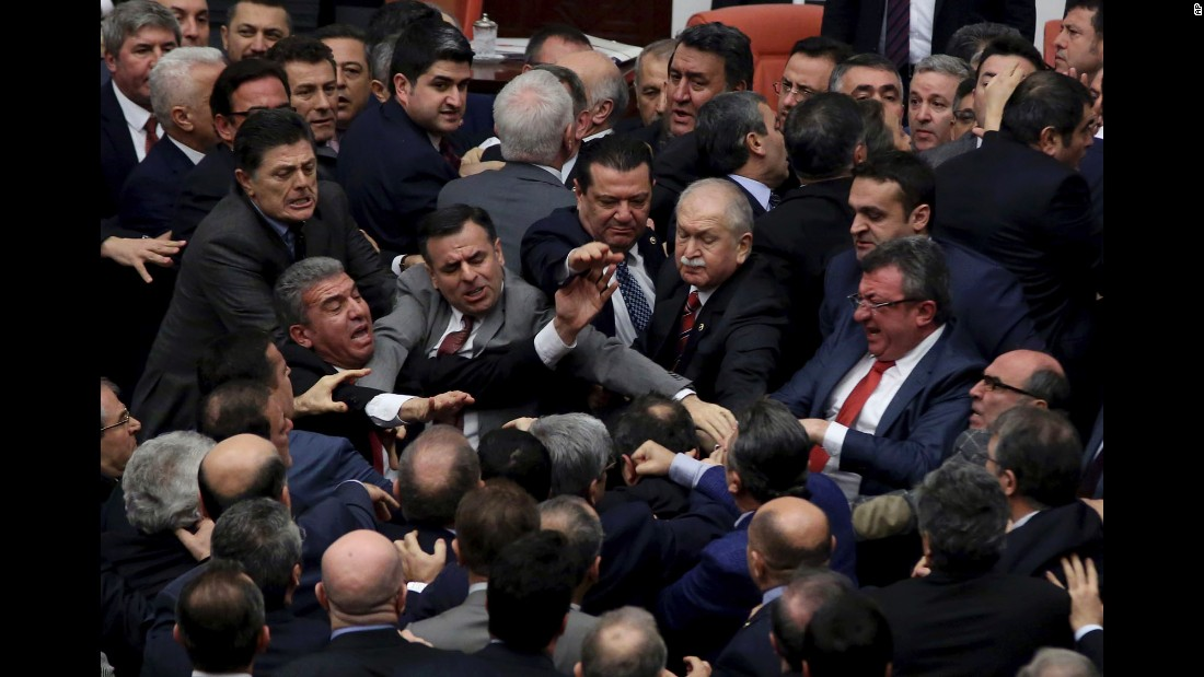 "Lawmakers scuffle in Turkey's parliament on Wednesday, January 11. <a href=""http://www.cnn.com/2017/01/12/europe/turkey-parliament-brawl/"" target=""_blank"">The brawl broke out </a>during a debate over constitutional amendments that would expand presidential powers, according to state news agency Anadolu."