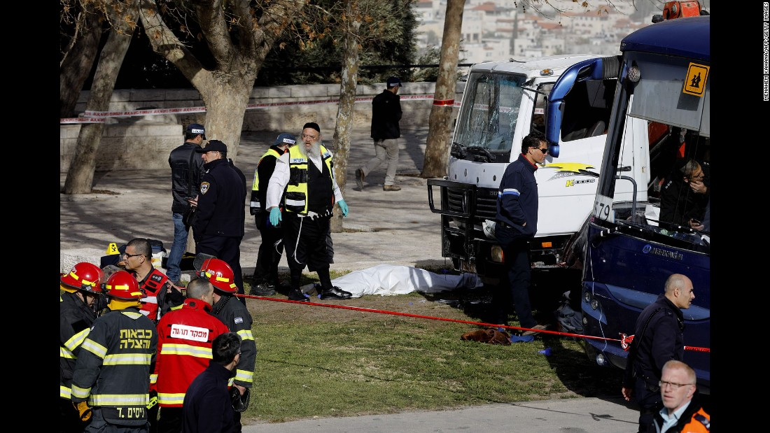 "Israeli security forces and emergency personnel gather at the site of <a href=""http://www.cnn.com/2017/01/08/middleeast/jerusalem-vehicle-attack/index.html"" target=""_blank"">a truck attack in Jerusalem</a> on Sunday, January 8. A driver plowed a truck into a group of soldiers in Jerusalem, killing four people and injuring at least 10."