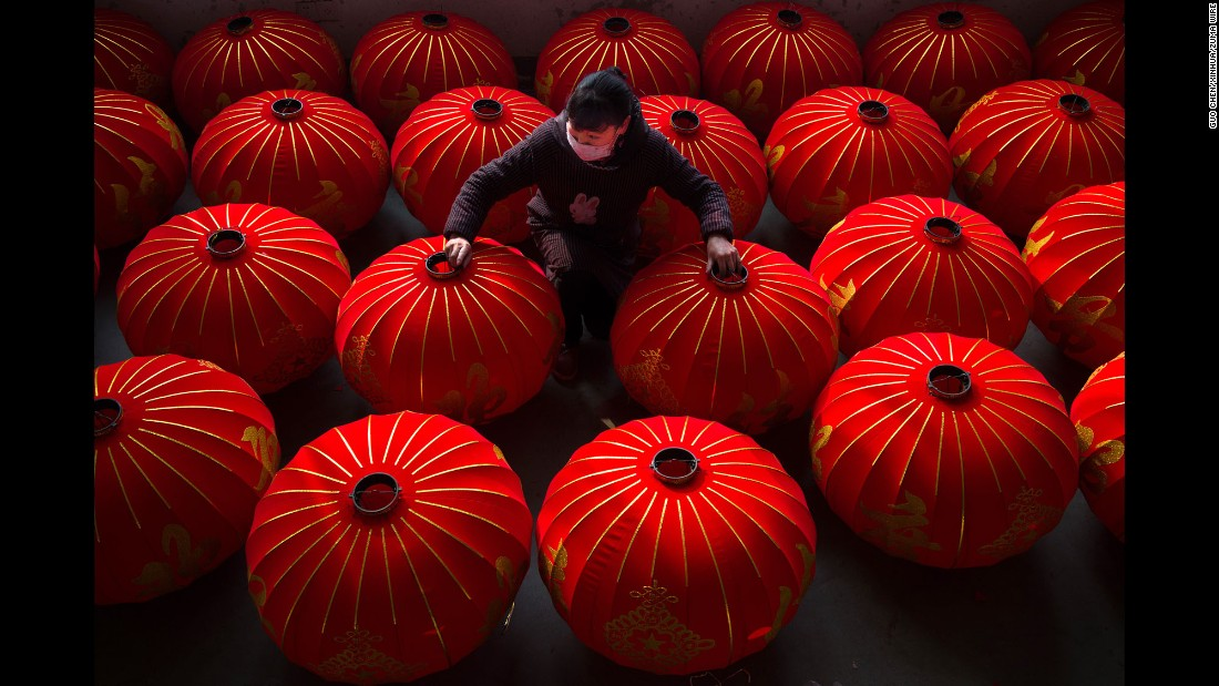 A worker organizes semi-finished lanterns at the Kaiming Lantern Factory in Hefei, China, on Wednesday, January 11.