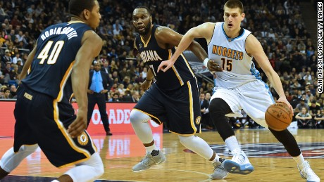 Denver forward Nikola Jokic leads the attack against the Pacers.