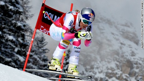 The US's Lindsey Vonn competes to win the women's World Cup downhill event of the FIS Ski World Cup in Cortina D'Ampezzo on January 18, 2015. US Lindsey Vonn won ahead of Austira's Elisabeth Goergl and Italy's Daniela Merighetti. American ski great Lindsey Vonn equalled the record of overall World Cup wins on January 18 as she recorded her 62nd victory in the women's downhill at the Italian resort of Cortina d'Ampezzo. AFP PHOTO / ALBERTO PIZZOLI        (Photo credit should read ALBERTO PIZZOLI/AFP/Getty Images)