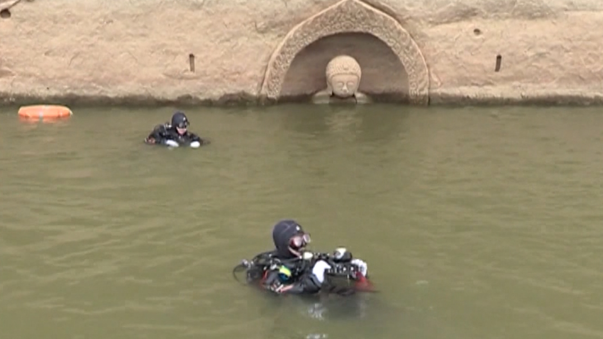 sunken 600 year old buddha emerges from water in china cnn travel