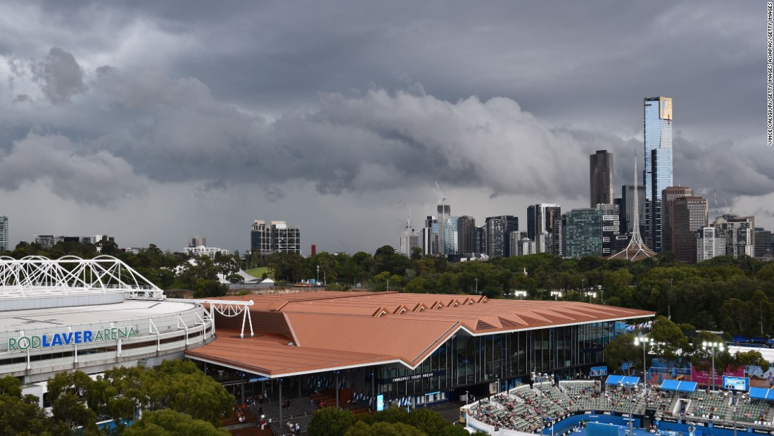 The city of Melbourne towers in the skyline behind Melbourne Park and the Rod Laver Arena -- the tournament's main show-court.