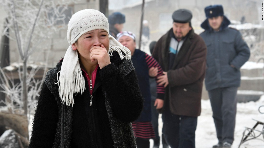 Relatives of victims react as Kyrgyz emergency officials search through the debris of the crash. At least eight people were hospitalized, Kyrgyzstan's state-run Kabar Agency reported.