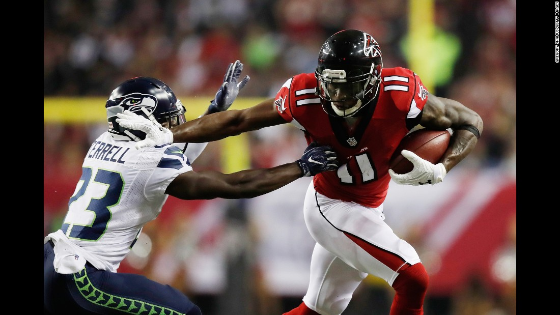 Atlanta Falcons wide receiver Julio Jones, right, stiff-arms Seattle Seahawks safety Steven Terrell during the NFC divisional playoff game on Saturday, January 14, in Atlanta. The Falcons defeated the Seahawks 36-20 and will advance to the NFC Championship against the Green Bay Packers.