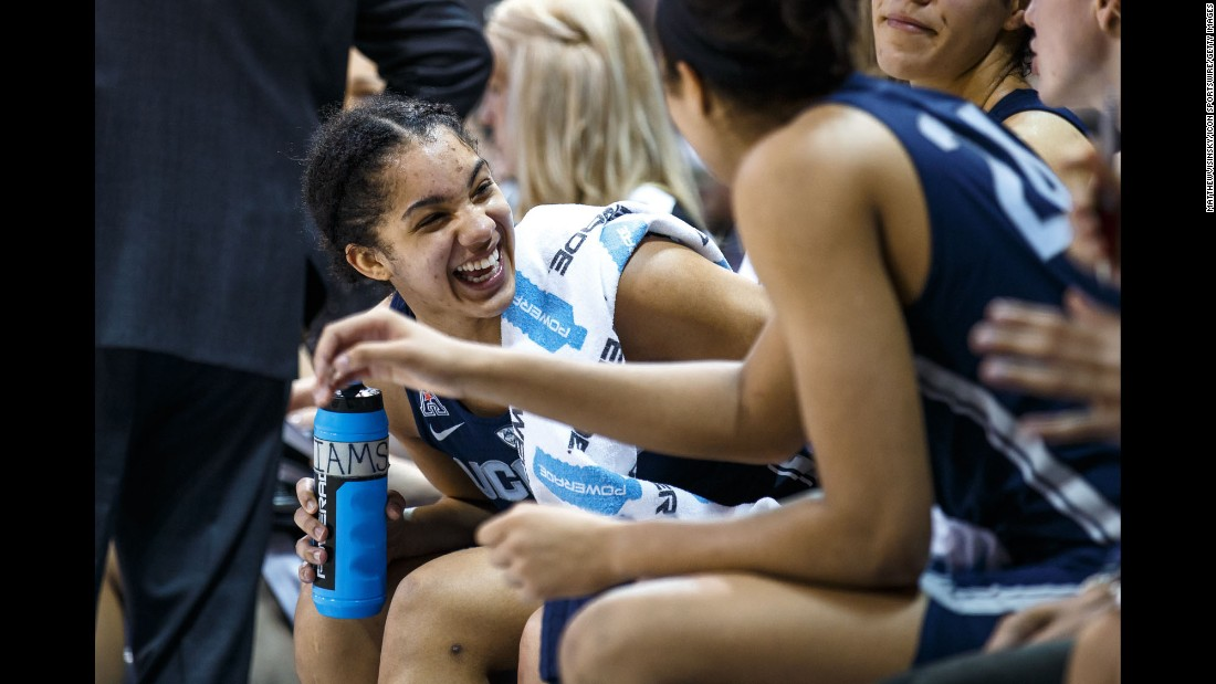 UConn Huskies forward Gabby Williams laughs with teammates during the American Athletic Conference college basketball game against the SMU Mustangs on January 14. The Huskies won the game 88-48, setting an NCAA record with their 91st consecutive win.