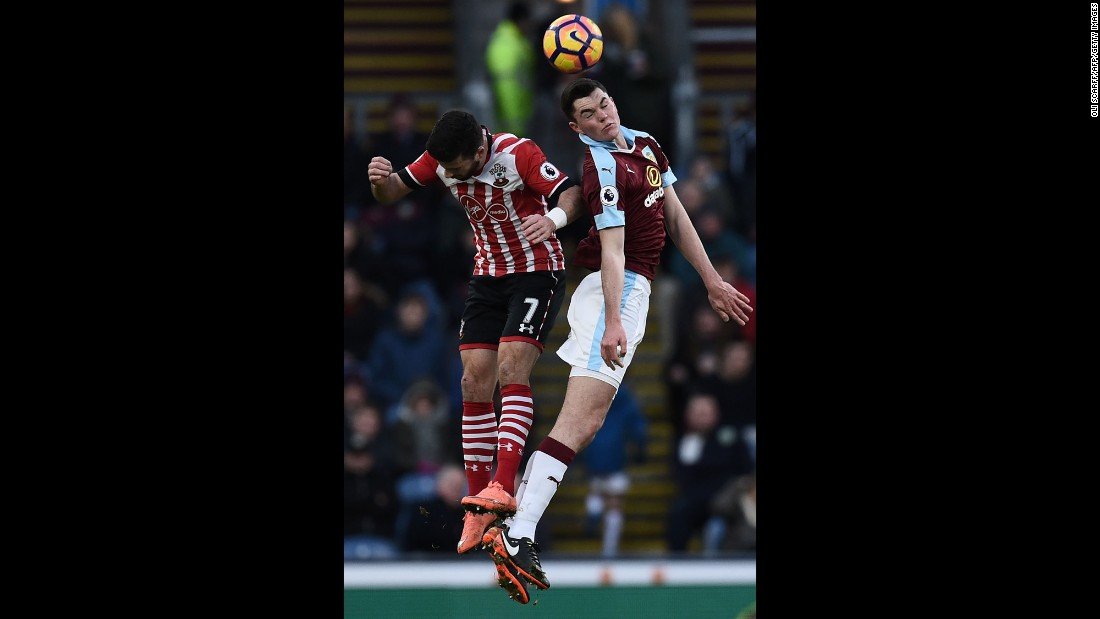 Burnley's English defender Michael Keane, right, and Southampton's Irish striker Shane Long jump to head the ball during an English Premier League football match in Burnley, England, on January 14.