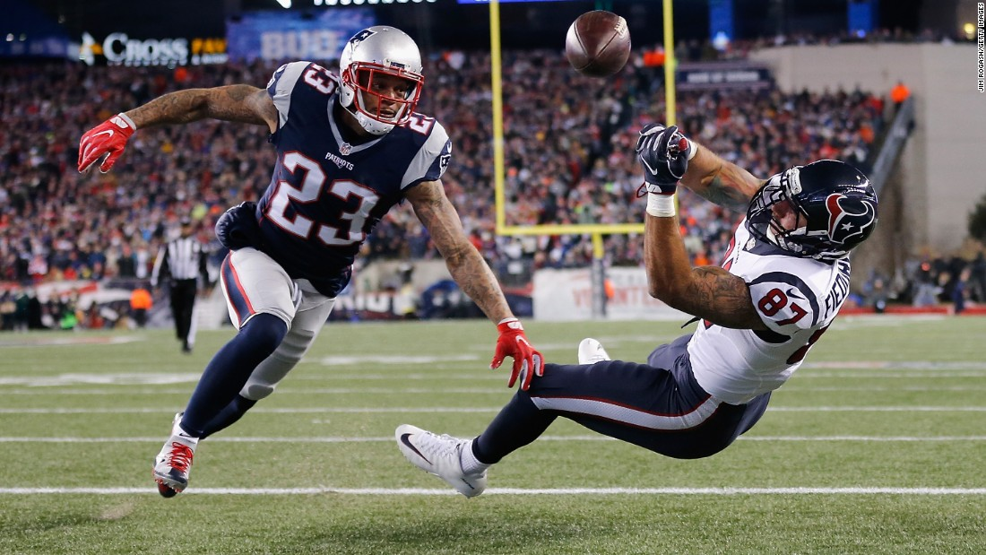 Patrick Chung of the New England Patriots, left, watches as C.J. Fiedorowicz of the Houston Texans misses a catch in the first half during the AFC Divisional Playoff Game on January 14 in Massachusetts. The Patriots won 34-16.