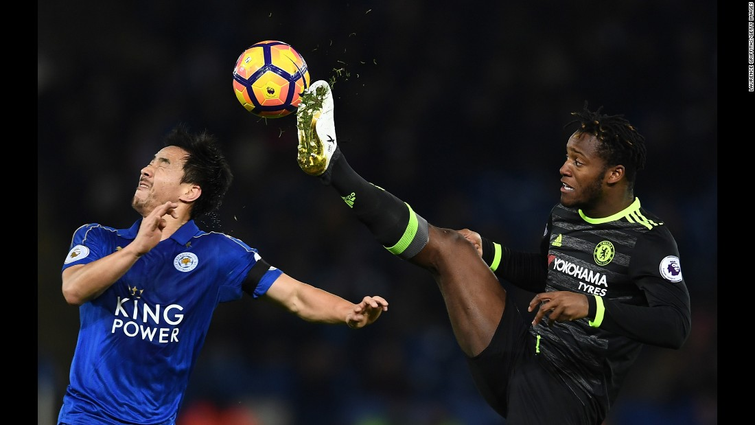 Shinji Okazaki of Leicester City, left, reacts as Michy Batshuayi of Chelsea battles for the ball during the Premier League match on January 14 in Leicester, England.