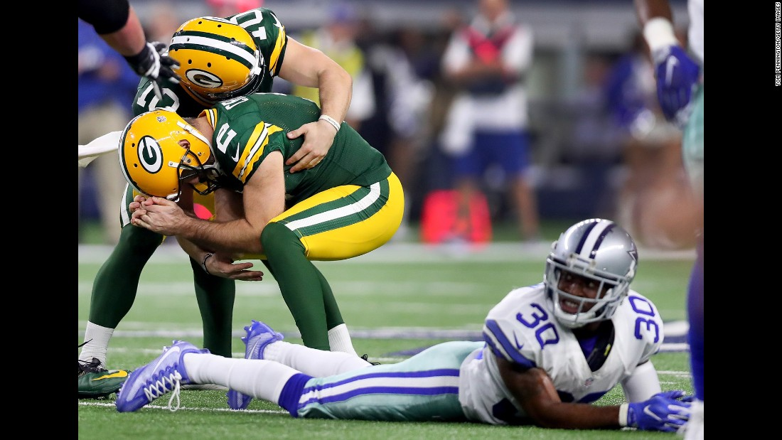 Green Bay Packers kicker Mason Crosby, second left, celebrates with Jacob Schum after scoring the game-winning field goal against the Dallas Cowboys in the final seconds of the NFC Divisional Playoff game on January 15. The Packers beat the Cowboys 34-31.