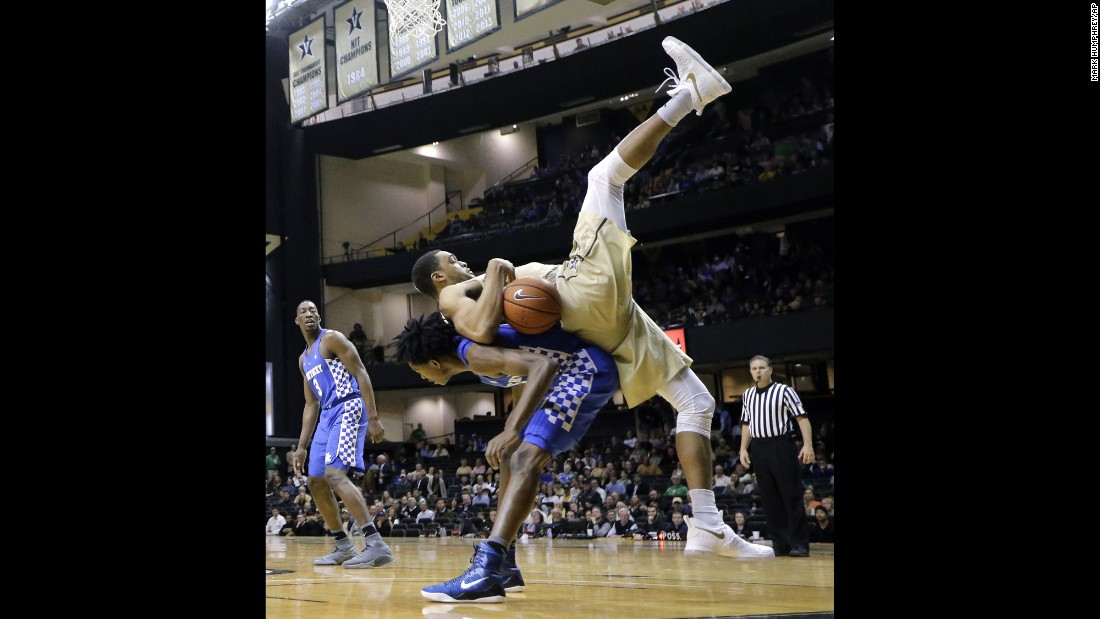 Vanderbilt forward Jeff Roberson, in gold, lands on Kentucky guard De'Aaron Fox during the first half of an NCAA college basketball game on January 10 in Nashville.