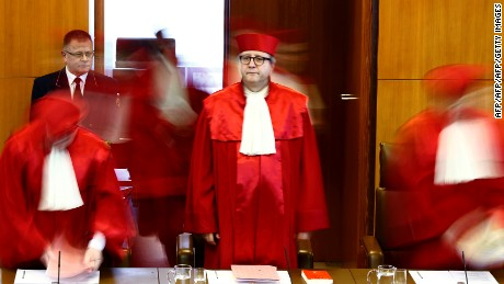 The President of Germany's Constitutional Court Andreas Vosskuhle (C) and judges of the court's Second Senate arrive to proclaim the verdict on a possible ban of Germany's right-extremist NPD party at the Federal Constitutional Court (Bundesverfassungsgericht) in Karlsruhe, southwestern Germany, on January 17, 2017. Germany's top court rejected the bid to ban the NPD, the second against the neo-Nazi party after the first one failed in 2003. / AFP / POOL / KAI PFAFFENBACH        (Photo credit should read KAI PFAFFENBACH/AFP/Getty Images)