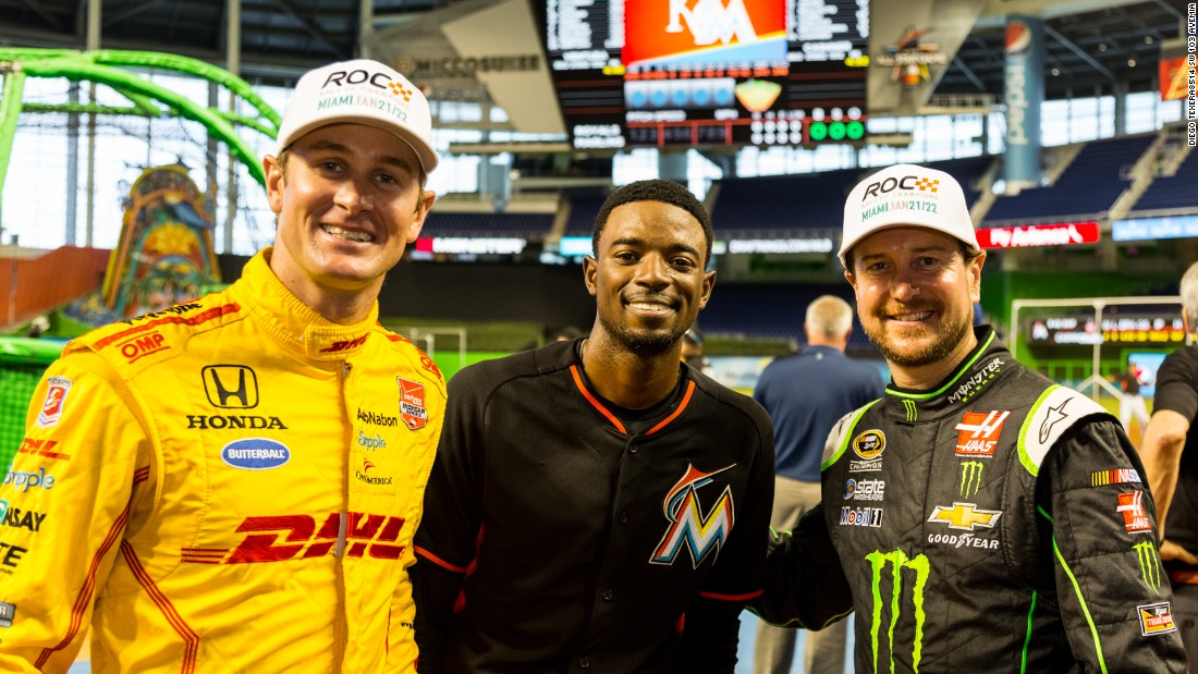 The 2014 Indianapolis 500 winner Ryan Hunter-Reay (left) and NASCAR driver -- and baseball fan -- Kurt Busch (right) meet Miami Marlins second baseman Dee Gordon ahead of ROC.