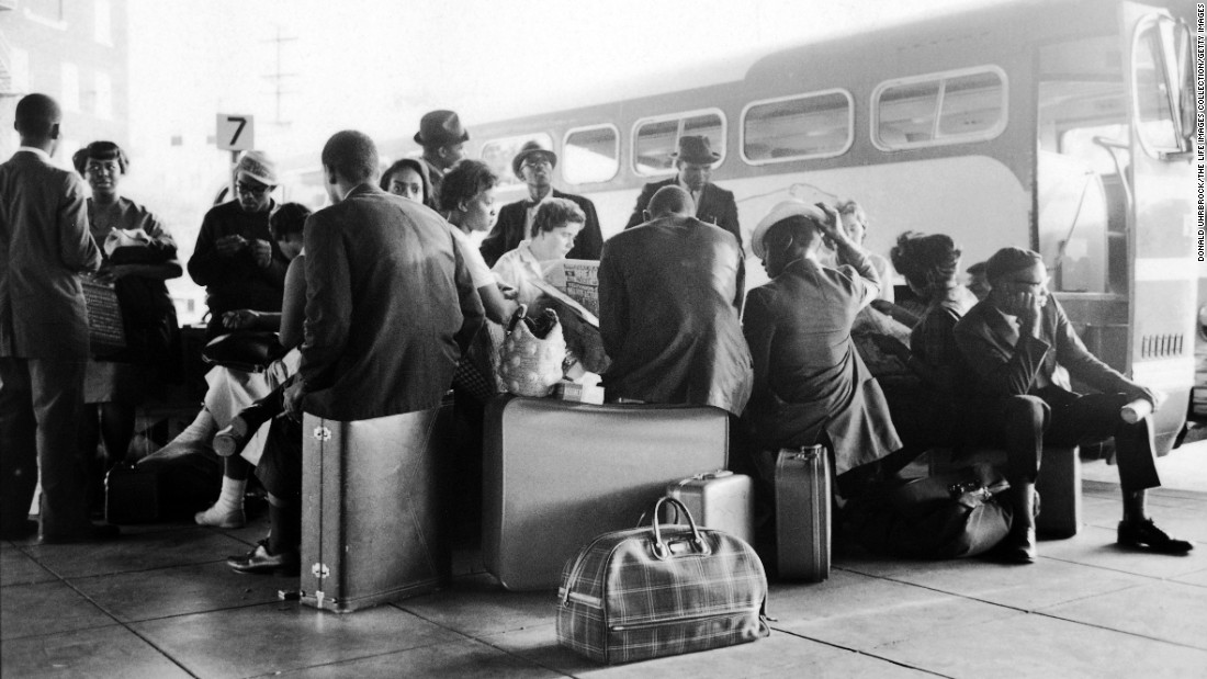 Civil rights activists known as Freedom Riders sit at a bus station in Birmingham, Alabama, in May 1961. That month, the Freedom Ride movement began with interstate buses driving into the Deep South to challenge segregation that persisted despite recent Supreme Court rulings. In some cities, the activists were arrested and brutally beaten.