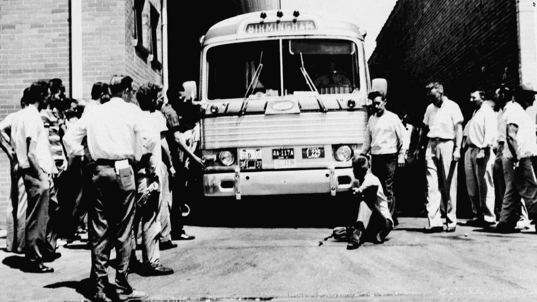 A white man in Anniston, Alabama, sits in front of a bus to prevent it from leaving the station with a load of Freedom Riders on May 15, 1961.
