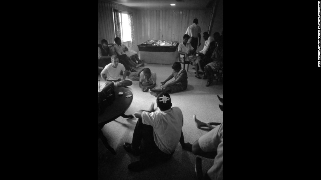 Lewis, with his head bandaged, relaxes with fellow Freedom Riders at a safe house in Montgomery.