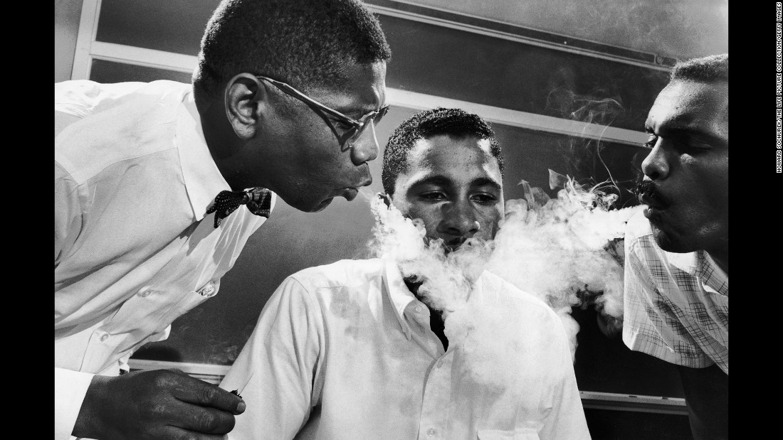 Activists would often undergo tolerance training to prepare themselves for what they might encounter during a sit-in. Here, NAACP student adviser David Gunter, left, and Leroy Hill blow smoke into the face of Virginius Thornton.