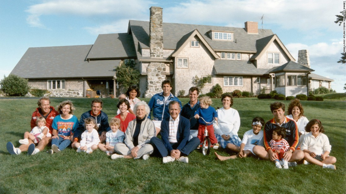 George and Barbara Bush pose for a family photo in 1986 in Kennebunkport, Maine. From left to right (not including children); Neil and Sharon Bush, George W. and Laura Bush, Barbara and George Bush, Margaret and Marvin Bush, Bobby Koch and Dorothy Bush Koch, and Jeb and Columba Bush.