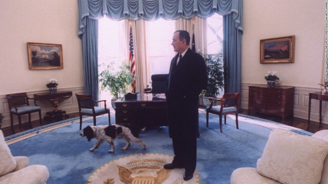 Bush takes a last look around the Oval Office with his dog, Ranger, before vacating the White House for newly-elected President Bill Clinton.