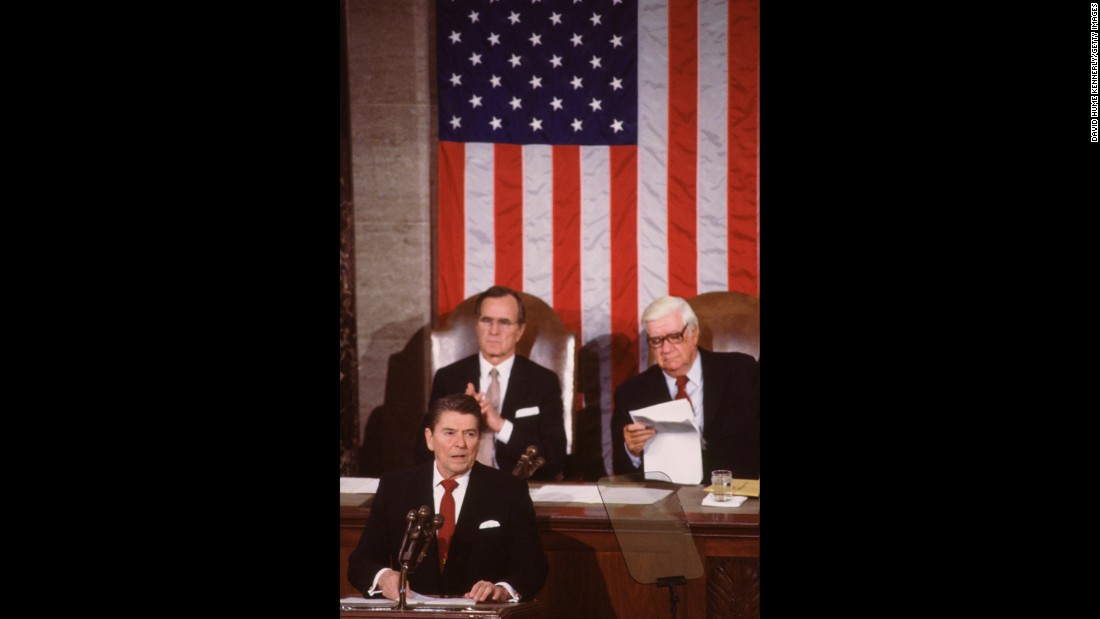 Bush and then-House Speaker Tip O'Neill listen to Reagan deliver his second State of the Union Address in 1983.