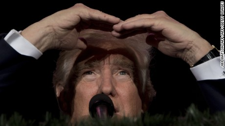 US President-elect Donald Trump looks on while speaking during a 'Thank You Tour 2016' rally in Orlando, Florida on December 16, 2016. / AFP / JIM WATSON        (Photo credit should read JIM WATSON/AFP/Getty Images)